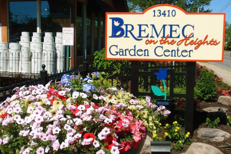 front sign at Bremec on the Heights Garden Center with flowers